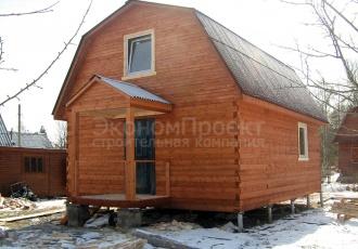 дом из бруса с мансардой под ключ сбоку